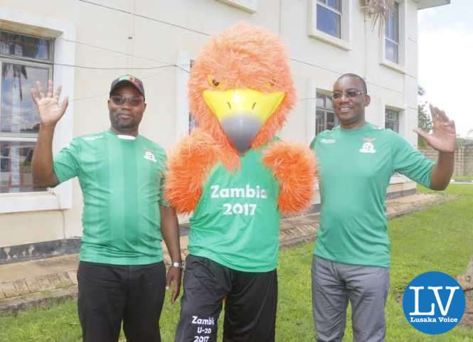 Sports Minister Moses Mawere with FAZ President Andrew Kamanga posing with U20 AFCON Championship mascot